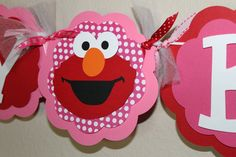 Elmo Birthday Banner;-) The pink back drop makes it girly and fun!