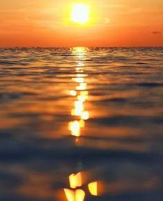 The Sun over the sea