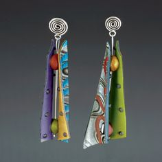 Razor Shell Pattern Mix by Arden Bardol. Handcrafted polymer clay forms the body of this piece. Each earring is formed by back-to-back, rounded elongated triangular shapes with polymer spacers separating the wings. Each earring within the set is one of a kind. The earring finding is sterling silver. Each piece is lightweight and is approximately 2.75 inches long.