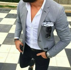 Grey blazer, white shirt, black jeans, dark brown shoes