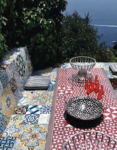 Oh, I think I found paradise. This place is a dream spot on the island of Capri. Nested on the heights of the island, the house enjoys a fantastic sea view thank to its many outdoor rooms. The use throughout the house of unique and colorful tiles, from the kitchen to the outdoors masonry tables...