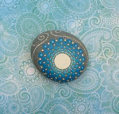 Mandala Stone: Hand painted with acrylic and protected with a matt finish, each stone is 2.5–3 inches diameter and is one-of-a-kind.