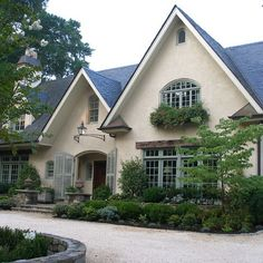 White and Blue House french country landscaping!  Can't believe how much this home looks like mine! Love gables~