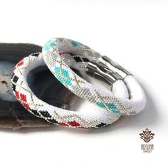 Argayl. Bead crochet bracelet with geometric ornament, white, black, red, silver / white, mint, grey, silver. Classic bracelet