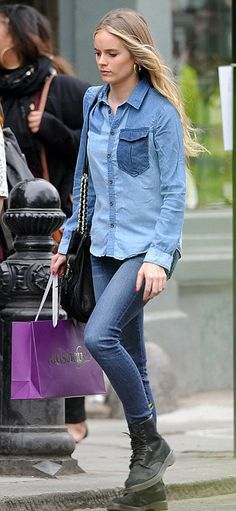Cressida Bonas The 25-year-old paired dark skin tight jeans with a light denim shirt and Doc Martin boots  Read more: http://www.dailymail.co.uk/femail/article-2607779/Moody-blues-Cressida-Bonas-dares-wear-double-denim-strolls-shopping-trip.html#ixzz2zFyeg41f Follow us: @MailOnline on Twitter | DailyMail on Facebook