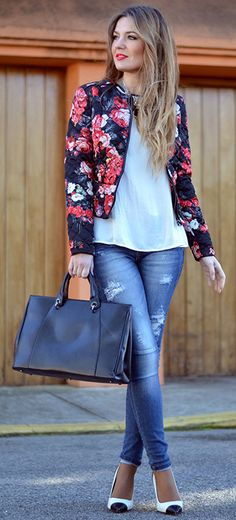 Floral bomber jacket with white and black cap toe heels distressed jeans and a black handbag | Street Style