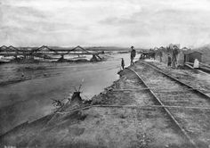 In 1886, the river washed out the adjacent tracks of the Santa Fe Railroad. The Downey Avenue Bridge, visible in the background, was also destroyed. Courtesy of the Title Insurance and Trust / C.C. Pierce Photography Collection, USC Libraries.