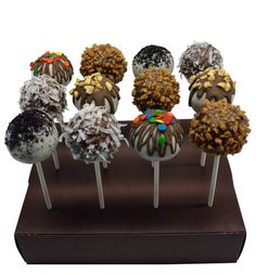 Classic Cake Pops: The youthful whimsy of a lollipop and the sophistication of specialty cake flavors and toppings make for a fun and delicious, yet classy, dessert for anyone to enjoy on just about any occasion. Classic Cake Pops: Cake flavor, chocolate dipped (white or milk), with assorted toppings, coconut, toffee chip, nuts, sprinkles & Oreo Cookie. #floral #bouquets #flowerarrangements #beautiful #nancysfloral #love #flowers #Gresham #Oregon #Cupcakes #GourmetCupcakes #CakePops