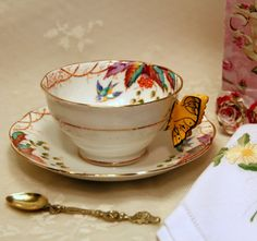 We are delighted to offer an exceedingly rare, highly sought after collectable, Royal Albert Crown China Companys Virginia Yellow Butterfly Handle Teacup in the almost impossible to find Avon cup shape, which features the hand painted artistry in great detail on the inside of the fine bone china cup. The backstamp marks this cup as the original year, 1927, for this unique and beautiful English pattern. The butterfly handle teacups of this period are virtually nonexistent any longer because…