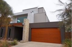 Architectural Panel Systems has manufactured architectural cladding for projects in Melbourne, Barwon Heads, Torquay and Pt Lonsdale. Cladding Panels, Panel Systems, Melbourne, Garage Doors, Exterior, Architecture, Building, Outdoor Decor, Modern