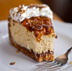 Toffee crust smeared with a layer of milk chocolate under a creamy caramel cheesecake with crunchy toffee, caramel, and whipped cream on top.