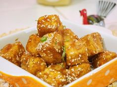 Pan-Fried Sesame Tofu (extra-firm tofu, honey, tamari, finely chopped ginger, sesame oil (not toasted), rice vinegar, garlic cloves, red pepper flakes, cornstarch or flour for dusting, canola oil, sesame seeds (lightly toasted), and 6 green onions)