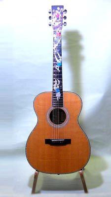 """Martin OM Night Dive (2004) : This Martin guitar, limited to 100,  is a collaborative work between Canadian luthier William """"Grit"""" Laskin, the technical inlay wizards of Pearl Works and the craftspeople from the Martin Guitar."""