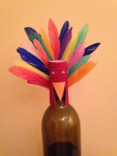 I made this Turkey wine bottle topper to go along with a bottle of wine I gave as a thanksgiving hostess gift :)