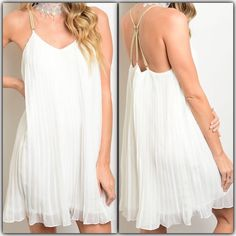 New Arrival  Stunning White Dress Coming Soon Stunning White Dress Spaghetti Straps, scrappy Back. Fully Lined   97% Polyester 3% Spandex   Available in Small Medium &  Large Dresses