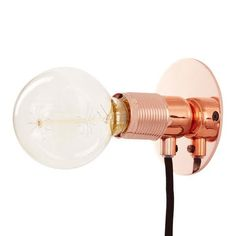The E27 Wall Light in Copper is an industrial inspired wall light with hints of luxury which is showcased through the metallic hues, black graphite cable + round lines.   The luxe yet simple design makes it eye-catching enough to be showcased in any space; either in a reading nook, as modern bedside lamps or simply as statement wall lights.  Please note that the bulb has to be purchased separately; this light truly comes into it's own with a decorative filament bulb. You can see our range…