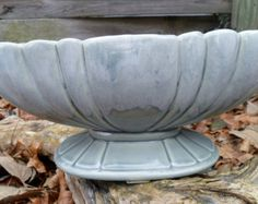 "Vintage Sage Green Planter Marked USA $15.00 | This is a sage planter marked USA. It has a pedestal base with beautiful scallop sides. It has a glazed finish. It  is 12"" long by 5 1/2"" wide and  5 1/4"" tall.  The base -is 7 1/4"" long, 5"" wide, 1 1/2"" tall.  Planter is in great vintage condition.  No chips or cracks."