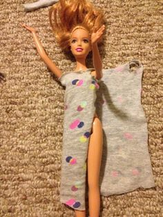 Easy no sew dress. Full how to found here: http://threejs-y.blogspot.com/2013/08/no-sew-barbie-doll-clothes.html