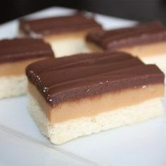 Caramel Shortbread Squares Recipe These cookies consist of a shortbread crust firm caramel center and a milk chocolate top. They are super-easy to make and they take only 20 minutes to bake. British Baking Show Recipes, British Bake Off Recipes, British Desserts, Great British Bake Off, Baking Recipes, Baking Ideas, British Meals, British Sweets, English Desserts