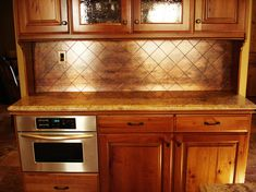 If we paint a gold color, the copper backsplash would look nice