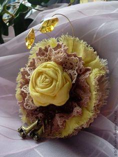 Idea for handmade flower - layer fabric rose onto small doily onto fabric rosette.