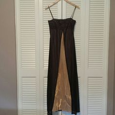 Black and gold formal dress Only worn once, still in great condition. Very light weight sheer material. Size says large but I think it fits more like a M or S Dresses
