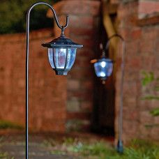Perfect for illuminating paths and borders, this 2 pack of rustic coach lanterns are solar powered and automatically light up at night. Designed in a stylish br. Small Garden Lanterns, Solar Garden Lamps, Garden Lamp Post, Solar Lantern Lights, Solar Patio Lights, Garden Design Plans, Lanterns Decor, Solar Led, Solar Panels