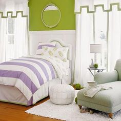 This room represents a completely different style, with the same color scheme. The purple and green combo still stands, but the stripes and bold wall color create a totally different look from the picture before. Notice how they use a softer shade of green for the chair as a complement.
