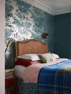 beautiful wallpaper, antique headboard, collected bedding