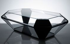 Alexandra von Furstenberg's Bullet Coffee Table - I know, it's a coffee table, but it would make an great coffin. Like being buried in a diamond!