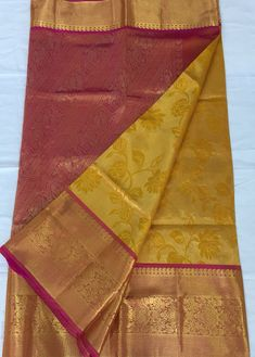 Yellow gadwal saree with kanjivaram border