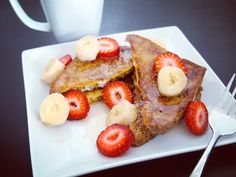 Ezekiel French Toast.  Ingredients 2 slices Ezekiel bread 2 eggs 2 tablespoons milk of choice  I used organic skim milk 1 tablespoon cinnamon 1 teaspoon honey (optional) 1 teaspoon coconut oil toppings of choice  I used pure maple syrup and sliced strawberries & bananas Instructions Heat a non-stick pan over a low to medium. Grease pan with the coconut oil. Scramble eggs milk cinnamon and honey in a medium bowl. Transfer egg mixture in a pie dish. Soak Ezekiel bread in the egg mixture for 15…