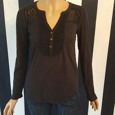 Lucky Brand Long Sleeve Ter This casual and comfortable long sleeve t-shirt has crochet detail at the top of both the front and the back. There are 3 copper buttons going down the front. This shirt is 60% cotton and 40% modal. Lucky Brand Tops Tees - Long Sleeve