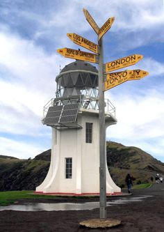 424px-Cape_reinga, via Flickr.  Cape Reinga Lighthouse is a lighthouse at Cape Reinga on the North Island of New Zealand. It was built in 1941 and first lit during May of that year. It was the last manned light to be built in New Zealand. In 1987, the lighthouse was fully automated & the lighthouse keepers were withdrawn. It is now monitored remotely from Wellington.  34°26′S 172°41′E