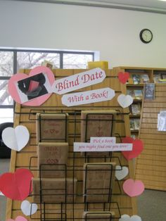 "Every February come on in to check out our ""Blind Date With A Book"" display...you might fall in love with a new book!"