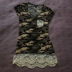 Rue 21 short sleeve shirt X-small Rue 21 short sleeve shirt.  Camo print with lace pocket and trim. Cute for any spring outfit! Worn a handful of times. Rue 21 Tops Tees - Short Sleeve