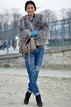 Master the effortlessly chic look in a grey fur coat and blue ripped boyfriend jeans. Polish off the ensemble with black suede ankle boots. Shop this look for $323: http://lookastic.com/women/looks/crew-neck-sweater-coat-bomber-jacket-satchel-bag-boyfriend-jeans-ankle-boots/4569 — Charcoal Crew-neck Sweater — Grey Fur Coat — Light Blue Leather Bomber Jacket — Brown Leather Satchel Bag — Blue Ripped Boyfriend Jeans — Black Suede Ankle Boots