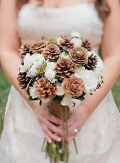Seasonal Wedding Ideas: Pine cone and white flower bouquet via Inspired by This