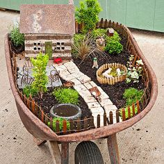 Fanciful and fun, this fairy garden found a home inside a vintage wheelbarrow. Rustic garden planters such as these are unique additions to a garden. Place them in a spot that gets enough sun for the plants, and drill holes in the base for drainage. Mini Fairy Garden, Fairy Garden Houses, Diy Garden, Gnome Garden, Garden Planters, Garden Ideas, Terrace Garden, Garden Boxes, Herb Garden