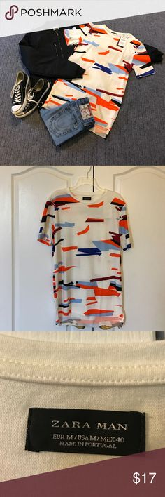 NWT Zara Men's Long-Line T-Shirt New, never worn, tags still attached. Absolutely no signs of wear including no stains, rips or odors. Features a cool modern geometric shape pattern in multiple shades of Blue, Orange, Red and Black. This T-shirt is longer than average and falls just below the waist at the top of the thighs. The sleeves are also slightly longer which gives it a cool baggy look. Pair with a stylish bomber or biker jacket for a great trendy look. Zara Shirts Tees - Short Sleeve