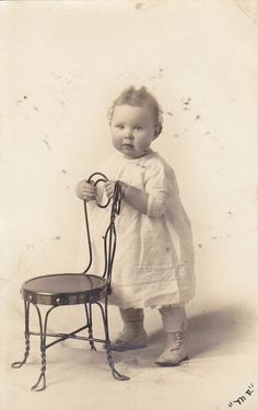 Sweet baby with small wire chair