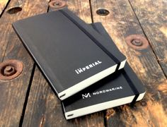 The most trusted name in notebooks, now with your logo. Reliable travel companion perfect for notes, sketches and thoughts. Bound hard cover with rounded corners, bookmark and elastic strap closure. Plain format, acid-free pages and expandable inner pocket. 240 pages. low as $19.88