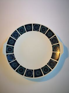 White round rimless plate with two small lugs from rim for handles, decorated around border with black squares with bold geometrical circles. Black Square, Cape Town, Shades Of Blue, Skyscraper, Retro Vintage, English, Plates, Ceramics, Purple