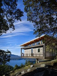 """Architect Jeb Thornburg designed this home on an Orcas Island mountainside to cantilever 28 feet in two directions. The rusticated steel frame is a nod to the character of the madrona bark, """"this kind of peeling red-brown; more interesting the older it gets."""""""