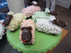 Sheep cakes (made by author with thick slices of Sara Lee pound cake, shaped and dipped in chocolate, frosted and covered with mashmellows and a chocolate dipped cookie for the head)