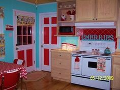 I'm trying to decide if red can play nicely with black countertops, white cabinets and wood floors. I don't really like how things look here...