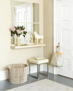 "If you want to brighten your entryway, create a ""window"" using basic bevel-edged mirrors. To start, prime and paint a floating shelf the same color as your walls to give it a seamless built-in effect; then install it three feet off the floor (standard height for a console). Add a grid of mirrors above, leaving about an inch around each to mimic windowpanes. For a flush, bracket-free look, attach the mirrors to the wall with construction adhesive made for mirrors."