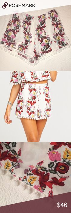 """Show me your MuMu floral shorts Show me your MuMu women's floral shorts.  Decorative pom Pom's line the bottom of the shorts all around.  Size: XL Color: Floral.  Waist: 30"""" Length: 13"""".  Back zip with clip closure. Show Me Your MuMu Shorts"""