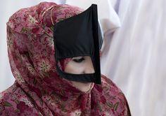 Oman    Bedouin women wear the Omani burqa, or mask, after reaching puberty. Sinaw   © Eric Lafforgue