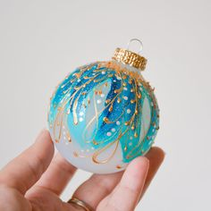 A sparkling jewel for your Christmas tree! Our line of Faberge-inspired ornaments look like they belong in the finest jewellery boxes. Everyone of these ornaments is handpainted and no two ever look the same. We began with a light glass bauble and handpainted a light design with fine Glass Christmas Balls, Gold Christmas Tree, Diy Christmas Ornaments, Christmas Items, Hand Painted Ornaments, Glass Ornaments, Disney Fine Jewelry, Turquoise Christmas, Etsy